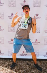 2017 Flagstaff Marathon runner posing in front of photo backdrop